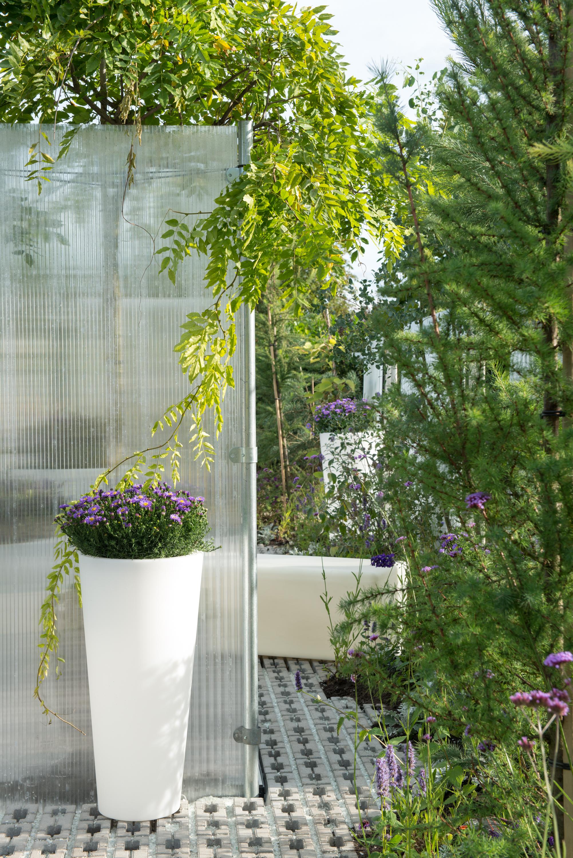 Tuin, trends, trendtuin, technologie, modern, automatisch, afwateringssysteem, zonwering, zonnepanelen, duurzaam